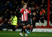 4th January 2020; Griffin Park, London, England; English FA Cup Football, Brentford FC versus Stoke City; Emiliano Marcondes of Brentford celebrates towards the Brentford fans after the final whistle - Strictly Editorial Use Only. No use with unauthorized audio, video, data, fixture lists, club/league logos or 'live' services. Online in-match use limited to 120 images, no video emulation. No use in betting, games or single club/league/player publications