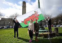 Lord Mayor for Swansea David Hopkins (R) Deb Vine (3rd L) and Julie Peconi (2nd L) raise a Wales flag in the shape of a red lobster instead of a red dragon outside the Guildhall, to raise awareness for Skin Care Cymru, in Swansea, Wales, UK. Tuesday 28 February 2017