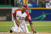 11 March 2009: #43 Hiram Bocachica is safe at home as he scores during the 2009 World Baseball Classic Pool D game 6 at Hiram Bithorn Stadium in San Juan, Puerto Rico. Puerto Rico wins 5-0 over the Netherlands