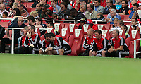 Pictured: Swansea bench, Alan Curtis (R) and Colin Pascoe (2nd R) with other coaching staff. Saturday 10 September 2011<br /> Re: Premiership Arsenal v Swansea City FC at the Emirates Stadium, London.