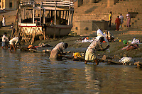 India, Uttar Pradesh, Varanasi, Ganges River, laundry men