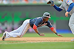 3 September 2012: Washington Nationals outfielder Roger Bernadina dives back to first base, avoiding a pick-off attempt, during a game against the Chicago Cubs at Nationals Park in Washington, DC. The Nationals edged out the visiting Cubs 2-1, in the first game of heir 4-game series. Mandatory Credit: Ed Wolfstein Photo