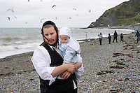 Mr Stern and baby Jonathan relax with their Hasidic family on the beach in Aberystwyth.