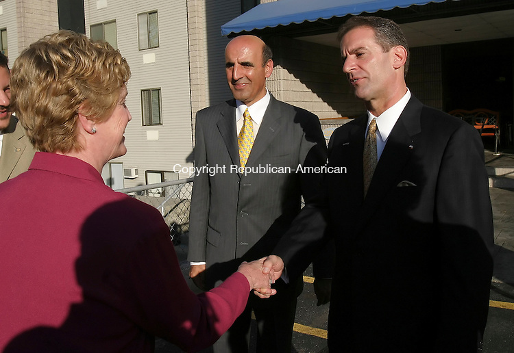 WATERBURY,  CT 04 October 2005 -100405BZ09-  Governor M. Jodi Rell, left,  talks with Rep. Selim G. Noujaim, R-74th District, center, and Republican Mayoral candidate Thomas Tremaglio, right, after addressing residents at the East Gate Apartments in support of Tremaglio Tuesday afternoon.<br /> Jamison C. Bazinet / Republican-American