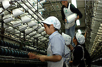 Workers at Wintex Textile Corporation textile factory in Fuzhou, Fujian province, China, owned by Taiwanese businessman Stanley Hsu..01-MAR-04