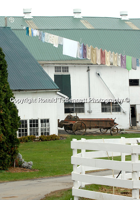 Manure spreader and barn with clean clothes on line,Commonwealth of Pennsylvania, Keystone state, Thirteen Colonies, Constitution Fine Art Photography by Ron Bennett, Fine Art, Fine Art photography, Art Photography, Copyright RonBennettPhotography.com © Fine Art Photography by Ron Bennett, Fine Art, Fine Art photography, Art Photography, Copyright RonBennettPhotography.com ©