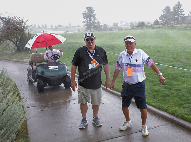 Fans walk in the rain during during the Barracuda Championship PGA golf tournament at Montrêux Golf and Country Club in Reno, Nevada on Friday, July 26, 2019.