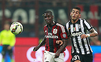 Calcio, Serie A: Milan vs Juventus, Milano, stadio San Siro, 20 settembre 2014.<br /> AC Milan defender Cristian Zapata, of Colombia, left, and Juventus midfielder Roberto Pereyra, of Argentina, fight for the ball during the Italian Serie A football match between AC Milan and Juventus at Milan's San Siro stadium, 20 September 2014.<br /> UPDATE IMAGES PRESS/Isabella Bonotto