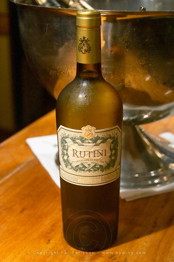 Bottle on a wooden bar counter of Rutini Sauvignon Blanc 2004, Bodega La Rural, Maipu, Mendoza The Rosa Negra Restaurant, The Black Rose, Buenos Aires Argentina, South America San Felipe, La Rural Vinedos y Bodegas Winery