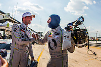 GTD pole winner Jeroen Bleekemolen, left, teammate Ben Keating, right, 12 Hours of Sebring, Sebring International Raceway, Sebring, FL, March 2015.  (Photo by Brian Cleary/ www.bcpix.com )