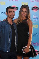 LOS ANGELES - AUG 11:  Joe Jonas, Blanda Eggenschwiler at the 2013 Teen Choice Awards at the Gibson Ampitheater Universal on August 11, 2013 in Los Angeles, CA