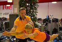 Februari 04, 2015, Apeldoorn, Omnisport, Fed Cup,  Netherlands-Slovakia, Fitnestrainer  Miguel Janssen and Michaela Krajicek (NED)<br /> Photo: Tennisimages/Henk Koster
