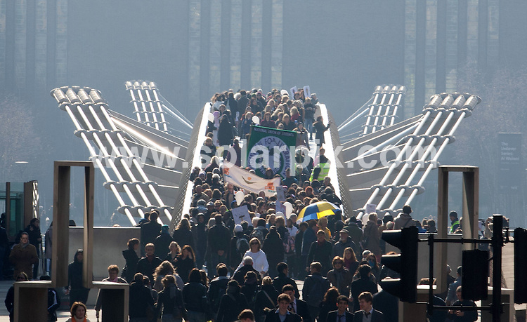 **ALL ROUND PICTURES FROM SOLARPIX.COM**                                             **NO UK NEWSPAPER PUBLICATION**.**UK MAGAZINE & SUPPLEMENT PUBLICATION ONLY** AND NO PUBLICATION IN AUSTRALIA, BELGIUM, FRANCE, GERMANY, ITALY, SCANDINAVIA AND USA**.Caption:  A group of high-profile women including Annie Lennox, Cherie Lunghi and Bianca Jagger marched to the Millennium Bridge in London  in aid of International Women's Day.. Part of a series of global events to mark the annual event (which celebrates its 100th anniversary today) and highlight the need for women's aid in Afghanistan                                                                             This pic: Annie Lennox                                                                                            JOB REF: 12938       SFE       DATE:  08.03.2011                                                          **MUST CREDIT SOLARPIX.COM OR DOUBLE FEE WILL BE CHARGED**                                                                      **MUST AGREE FEE BEFORE ONLINE USAGE**                               **CALL US ON: +34 952 811 768 or LOW RATE FROM UK 0844 617 7637**