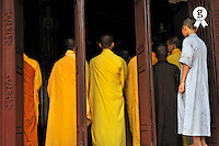 Monks in temple about to have lunch (Licence this image exclusively with Getty: http://www.gettyimages.com/detail/83154216 )