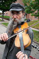 Older gentleman with long gray beard playing fiddle on the street. Grand Old Day Festival. St Paul Minnesota MN USA