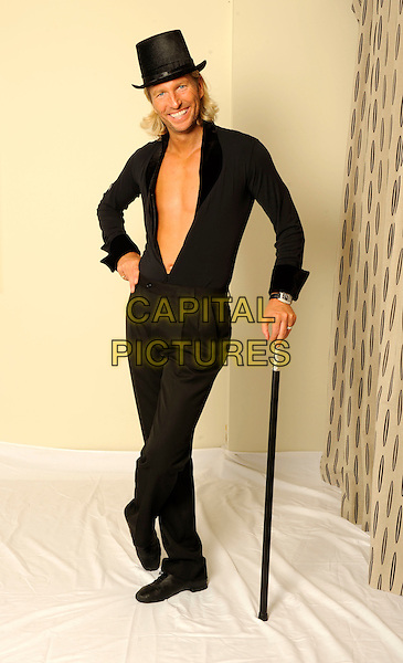 Robbie Savage .studio session, London, England 29th September 2011.**EXCLUSIVE ALL-ROUNDER**.full length topless chest black top hat shirt trousers cane hand on hip .CAP/FIN.©Steve Finn/Capital Pictures........THIS IS A SPEC PICTURE>FEE REQUIRED FOR USEAGE.CAP/FIN.©Steve Finn/Capital Pictures.