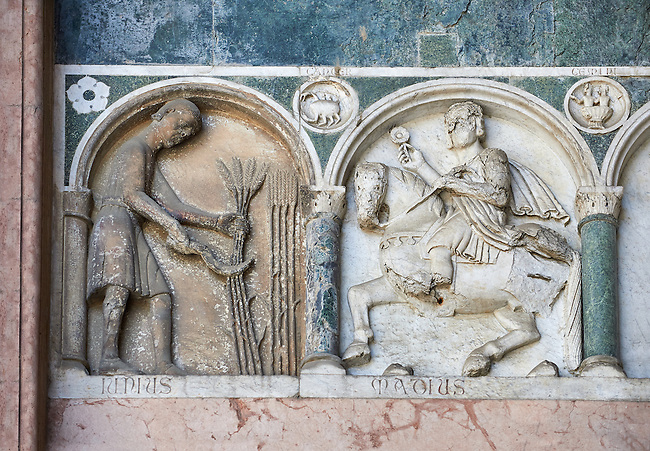 Late medieval relief sculpture depicting the labours for June and May and astrological signs on the Facade of the Cattedrale di San Martino,  Duomo of Lucca, Tunscany, Italy,