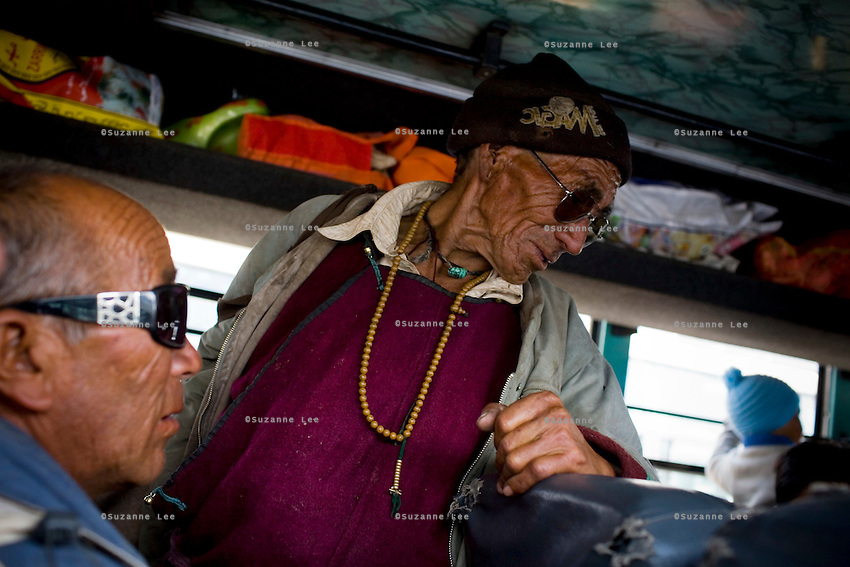 Ladakhi locals board the bus on 1st June 2009 on the way to Hemis and Ulley Valley, Ladakh, in the state of Jammu & Kashmir, India.  Photo by Suzanne Lee