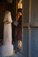 Working on a giant Phallus/penis in the Traditional Village of Sopsokha, Punakha District, Bhutan