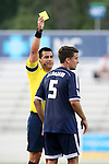 09 July 2014: Referee Ricardo Salazar (left) shows the yellow card to Carolina's Nazmi Albadawi (5). The Carolina RailHawks of the North American Soccer League played FC Dallas of Major League Soccer at WakeMed Stadium in Cary, North Carolina in the quarterfinals of the 2014 Lamar Hunt U.S. Open Cup soccer tournament. FC Dallas won the game 5-2.