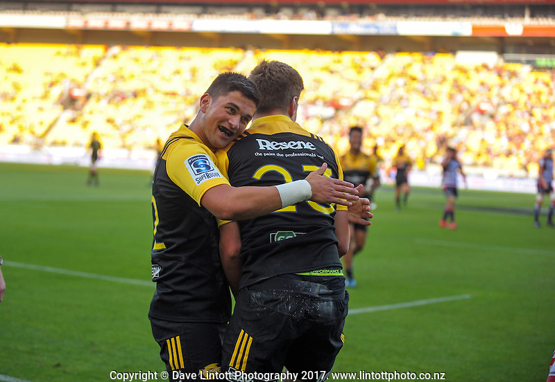Otere Black hugs Jordie Barrett during the Super Rugby match between the Hurricanes and Rebels at Westpac Stadium, Wellington, New Zealand on Saturday, 4 March 2017. Photo: Dave Lintott / lintottphoto.co.nz