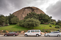 An Occidental College van sits under the Eagle Rock rock formation. Oxy students volunteered to weed and plant with the Eagle Rock Association as part of MLK Day of Service, January 26, 2013. (Photo by Marc Campos, Occidental College Photographer)