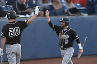 Peter Van Gansen (5) of the Cal Poly Mustangs is greeted by teammate Ryan Drobny (20) after scoring during a game against the Cal State Fullerton Titans at Goodwin Field on April 2, 2015 in Fullerton, California. Cal Poly defeated Cal State Fullerton, 5-0. (Larry Goren/Four Seam Images)