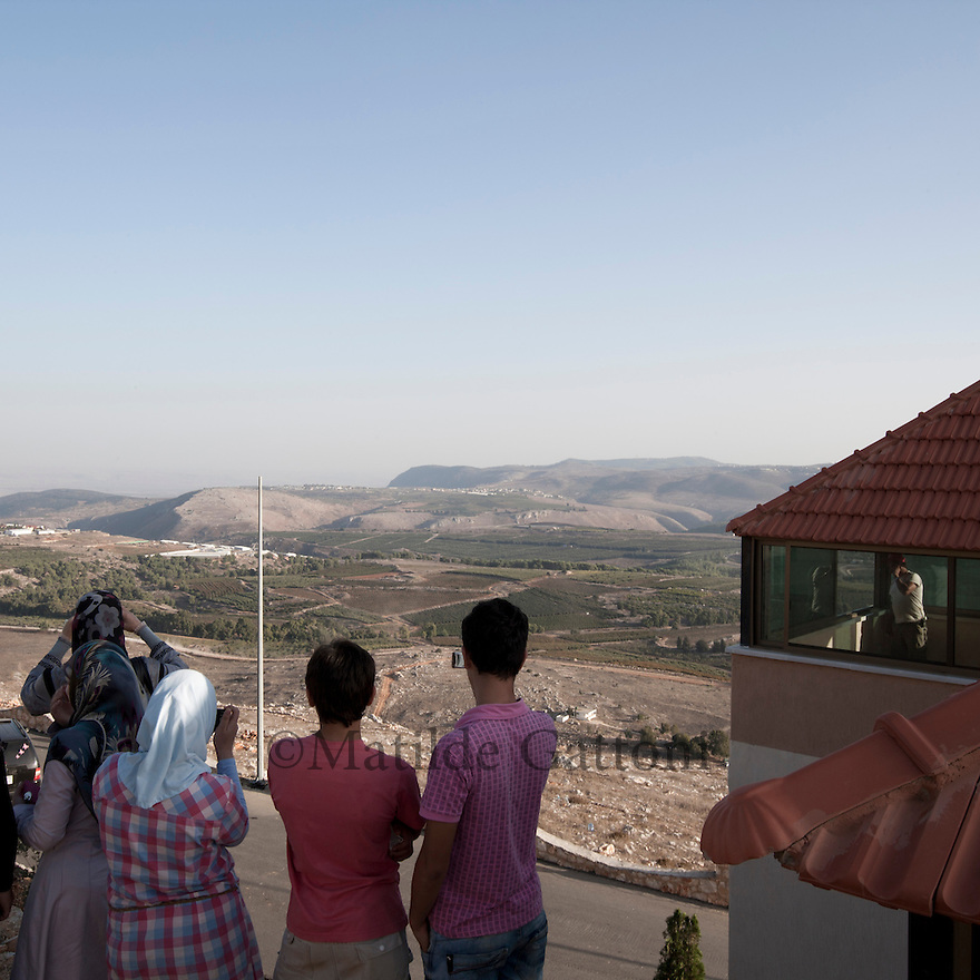 Lebanese family looking at the Israeli border from the park. During his first state visit to Lebanon in October 2010  Iranian President Dr. Ahmadinejad went to Bint Jbeil, a village at Israel-Lebanon border. Its the place where fierce battles between Hizbullah and the Jewish Army were fought. In addition to praising the courage of the Lebanese nation against the powerful enemy supported by the US, France, Germany and Britain  Dr. ahmadinejad also performed the inauguration ceremony of the Iran Park at Maroun al-Ras border area where streets are named after the Iranian cities...The Iranian government has funded and designed a lush park near the site of the battle, on the mountainside directly overlooking Israel. In the parking, visitors can stand at an observation point beside an Iranian flag fluttering in the wind, and look directly down at the Israeli hamlets of Avivim and Yiron.
