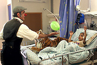 """Cris L'ariste an Israeli  medical clown who works in Hadassah and he is a member of a group call """"Dream Doctor"""", plays with Adham Takatka, 6, a Palestinian boy from the village of Marak Mu' Ala in the Bethlehem district, West Bank. Adham had a transplant of bone marrow received from his young brother Mohammed in the Hadassah Hospital.  Adham has blood tests twice a week in Hadasssah. Photo by Quique Kierszenbaum.  .."""