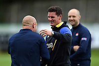 Freddie Burns of Bath Rugby says hello to Edinburgh Rugby Head Coach Richard Cockerill during the pre-match warm-up. Pre-season friendly match, between Edinburgh Rugby and Bath Rugby on August 17, 2018 at Meggetland Sports Complex in Edinburgh, Scotland. Photo by: Patrick Khachfe / Onside Images