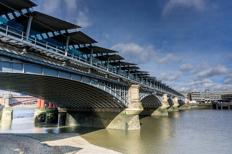 An old bridge across the river Thames in London