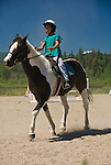 Young girl horseback riding