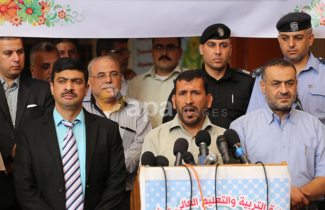Undersecretary of the Ministry of Education, Ziad Thabet, speaks during a press conference at a school, in Gaza city, on August 28, 2016. Photo by Mohammed Asad