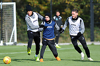 (L-R) Martin Olsson, Bersant Celina and Matt Grimes of Swansea City vies for possession during the Swansea City Training at The Fairwood Training Ground, in Swansea, Wales, UK. Wednesday 02 November 2018