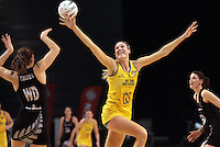 23.09.2012 Silver Ferns Kayla Cullen and Australian Caitlin Bassett in action during the third netball test match between the Silver Ferns and the Australian Diamonds at CBS Canterbury Arena in Christchurch. Mandatory Photo Credit ©Michael Bradley.
