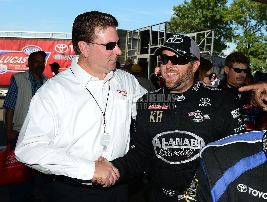 Jun. 3, 2012; Englishtown, NJ, USA: NHRA top fuel dragster driver Shawn Langdon (right) with Toyota Executive during the Supernationals at Raceway Park. Mandatory Credit: Mark J. Rebilas-
