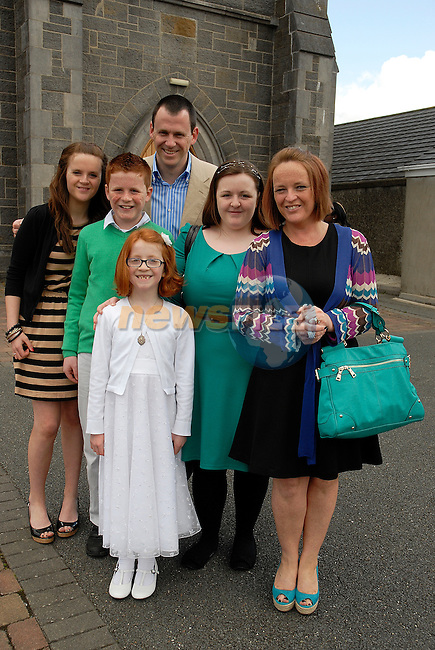 Mia Madden with her parents Declan and Margaret, sister Erin, brother Finn, Sarah at the First Holy Communion in Collon on Saturday.
