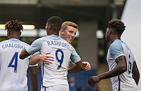 Matt Targett (Southampton) of England congratulates Marcus Rashford (Manchester United) of England on his goal during the International EURO U21 QUALIFYING - GROUP 9 match between England U21 and Norway U21 at the Weston Homes Community Stadium, Colchester, England on 6 September 2016. Photo by Andy Rowland / PRiME Media Images.