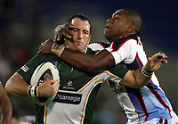 PICTURE BY VAUGHN RIDLEY/SWPIX.COM - Rugby League - Rugby League World Cup 2008 - Ireland v Fiji - Skilled Park, Gold Coast, Australia - 10/11/08...Copyright - Simon Wilkinson - 07811267706...Ireland's Ged Corcoran is tackled by Fiji's Waisale Suka.
