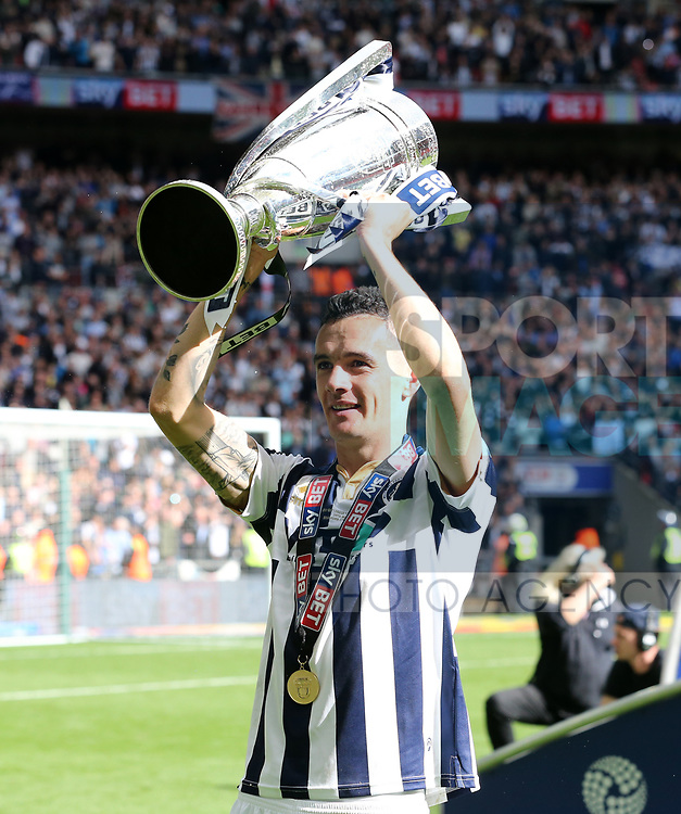 Millwall's Shaun Williams celebrates with the trophy during the League One Play-Off Final match at Wembley Stadium, London. Picture date: May 20th, 2017. Pic credit should read: David Klein/Sportimage