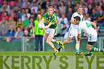 Colm Cooper hand passes the ball in the Muster Senior Semi final held in The Gaelic Grounds last Saturday evening.