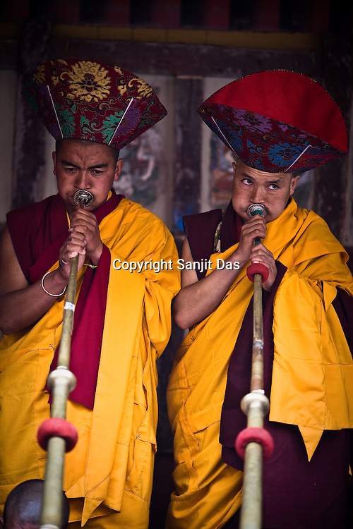 """Trumpeters at Hemis monastery herald the start of the Hemis festival at the Hemis Monastery (gompa) of the Drukpa Lineage, located in Hemis, 45 kms away from Leh in Ladakh. ..His Holiness the Twelfth Gyalwang Drukpa, the head of the Drukpa Lineage (proponents of the Mahayana Buddhist tradition) ended his """"Walking On The World's Rooftop"""" Pad Yatra from Manali to Hemis Monestary in Ladakh."""