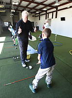 NWA Democrat-Gazette/FLIP PUTTHOFF <br /> EYE ON THE BALL<br /> Golf coach Mark Curlett gives a thumbs up Saturday March 16 2017 to Caleb Stevens, 10, of Rogers for Caleb's stance during a golf lesson at The First Tee of Northwest Arkansas in Lowell. Mission of The First Tee is to impact the lives of young people with programs that build character, instill values and promote healthy choices through the game of golf.