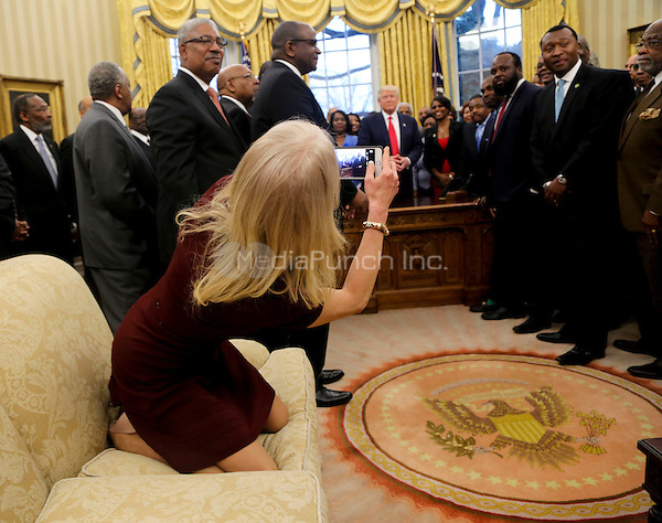 Counselor to the President Kellyanne Conway takes a picture of United States President Donald Trump with members of the Historically Black Colleges and Universities in the Oval Office of the White House, Washington, DC, February 27, 2017. <br /> Credit: Aude Guerrucci / Pool via CNP