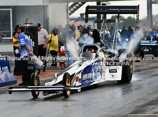 Terry Haddock #121, driver for Acme Refinings Top Fuel Dragster getting rewady to make a qualifying run at the O'Reilly Fall Nationals held at the Texas Motorplex in  Ennis, Texas.