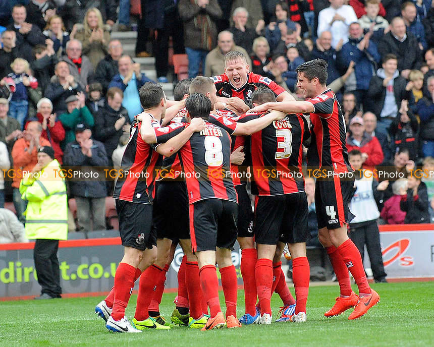 AFC Bournemouth players celebrate the goal by Tommy Elphick of AFC Bournemouth - AFC Bournemouth vs Queens Park Rangers QPR - Sky Bet Championship Football at the Goldsands Stadium, Bournemouth, Dorset - 05/04/14 - MANDATORY CREDIT: Denis Murphy/TGSPHOTO - Self billing applies where appropriate - 0845 094 6026 - contact@tgsphoto.co.uk - NO UNPAID USE