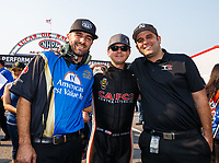 Sep 4, 2017; Clermont, IN, USA; NHRA top fuel driver Steve Torrence (center) with crew members Dom Lagana (left) and Bobby Lagana during the US Nationals at Lucas Oil Raceway. Mandatory Credit: Mark J. Rebilas-USA TODAY Sports