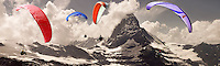 Paragliders over the Matterhorn mountain peak - Swiss Alps - Switzerland