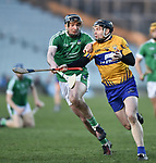 Declan Hannon of  Limerick in action against Tony Kelly of  Clare during their NHL quarter final at the Gaelic Grounds. Photograph by John Kelly.