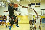 Madison Senators' Aubrey Stephens  (13) shoots the ball against Jefferson Democrats' Devaunte Paschal (22) in the second half at Jefferson High School.<br /> Photo by Jaime Valdez